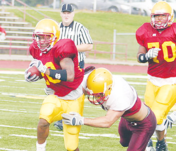 <span class='credit'>Photo Courtesy of Big Rapids Pioneer</span><span class='description'>Pressing On: Tailback Tyler Thomas bursts through an opening during a scrimmage on August 21st.</span>