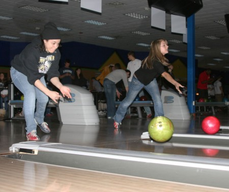 """Bowling for Kids: Nicole Allen, left, and Samantha Evans, right, bowl during the Big Brother Big Sisters """"Bowl for Kids' Sake"""" at the Gate. The event was a fundraising opportunity that took place on March 22-23 and raised $6,000. Photo By: Kate Dupon   Photo Editor"""