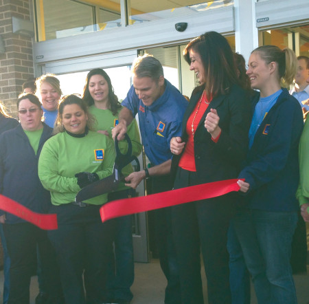 Manager Dean Quiggle cuts the ribbon marking the opening of the new Aldi grocery store in Big Rapids, located at 21481 Perry Ave. The store offers a variety of grocery products at a low price. Photo By: Taylor Hooper | News Writer