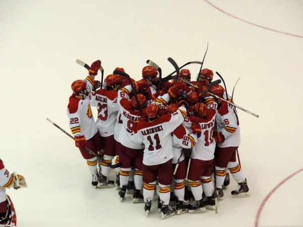 Ferris players storm the ice following their 1-0 win over Colgate in the NCAA Men's Div. I Midwest Regional