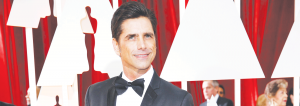 John Stamos plays the beloved Uncle Jesse in Full House and is directing the new show, Fuller House.