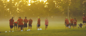 The women's soccer team practices for the upcoming season just as dawn breaks in this photo taken last fall.